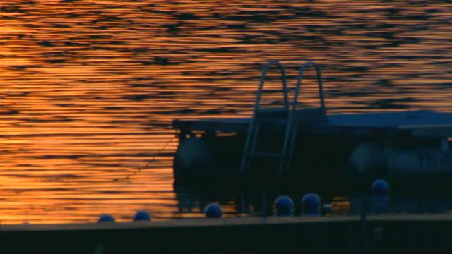 sunset over calm water, blur