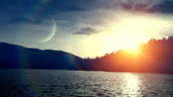 Sunset over lake (loopable)