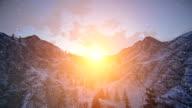 Sunset over snowy mountain ridge