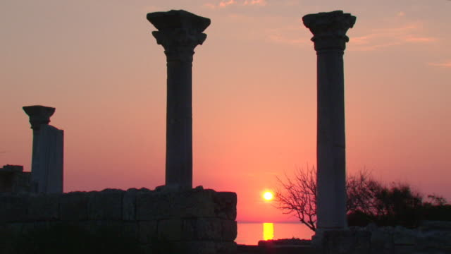 sunset over the ancient ruins