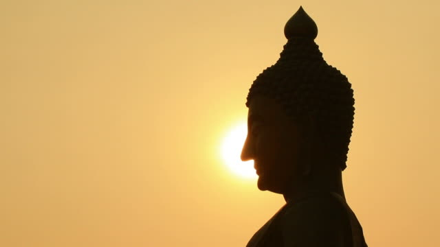 Sunset side big buddha statue silhouette