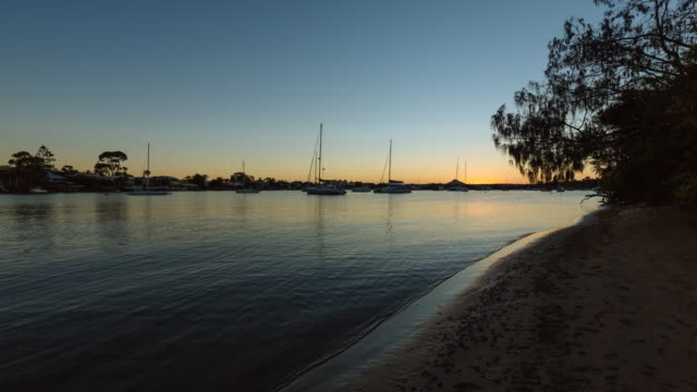 4K Sunset time lapse at Noosa with boats, Queensland, Australia