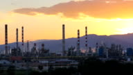 Sunset time lapse in oil refinery