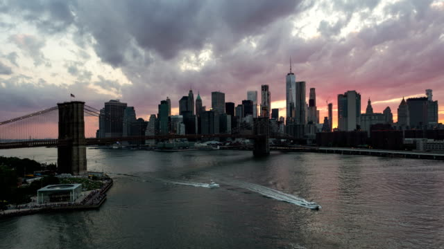 Sunset time lapse over Manhattan skyline and the Brooklyn bridgein New York City
