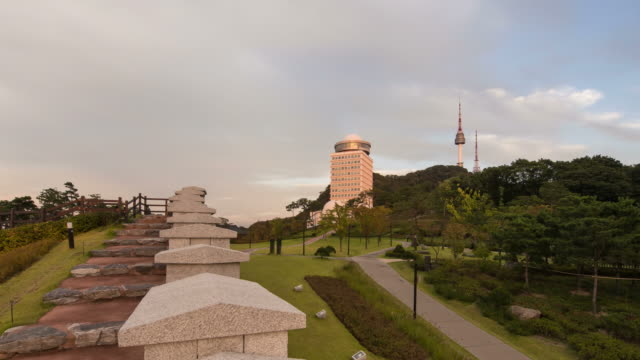 Sunset to night view of hill and fortified wall at the Baekbeomgwangjang plaza