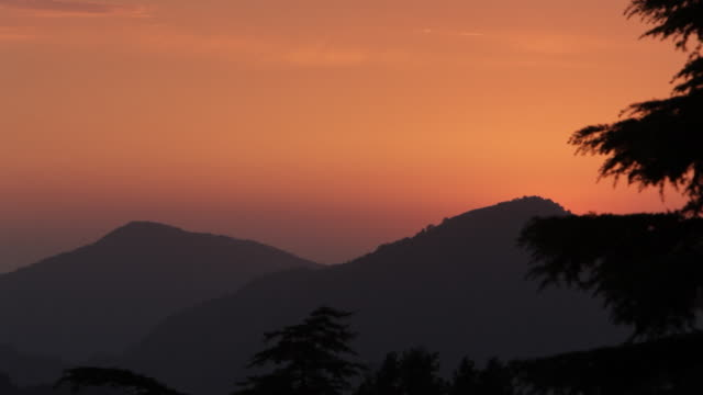 WS Sunset view of foothills of Himalayan mountains / India