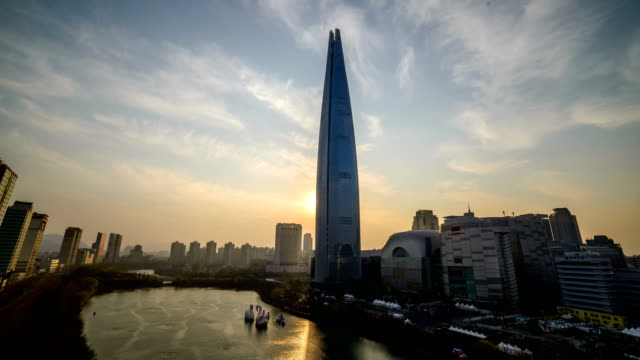 Sunset view of Lotte World Tower (The tallest building in Korea) and Seokchonhosu lake