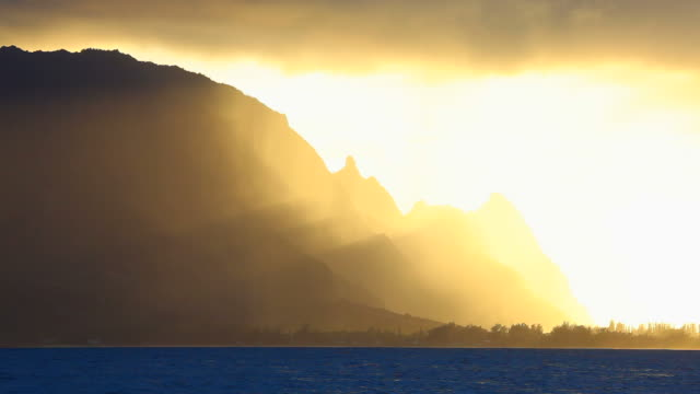 sunset with rain shower, kauai, hawaii