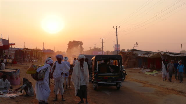 Sunsetting across a busy road leading to the Pushkar Camel Fair