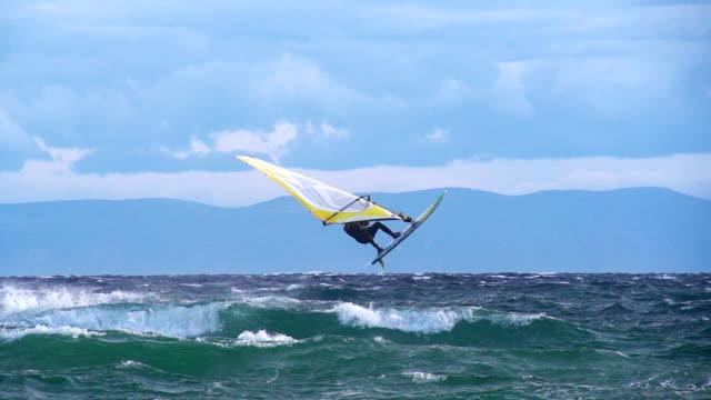 HD Super Slo-Mo: Man Jumping Wave on Windsurf Board