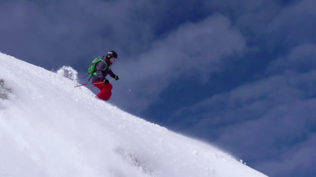 HD: Super Slo-Mo Shot of Young Free Ride Skier Jmping