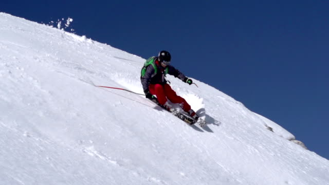 HD: Super Slo-Mo Shot of Young Free Ride Skier