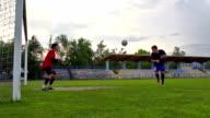 HD: Super Slo-Mo Shot of Young Goalkeeper Defending