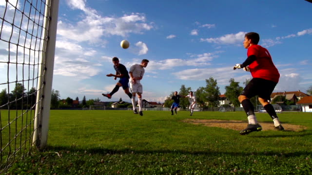 HD: Super Slo-Mo Shot of Young Soccer Players Scoring