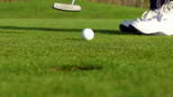 HD Super Slo-Mo:Shot of Golfball Reaching the Hole