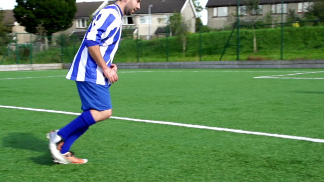 Super Slow Motion, Football, Soccer Player scores amazing Free Kick