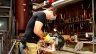 Super Slow Motion HD, Sparks fly Grinding metal in Workshop