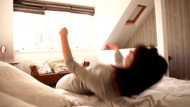 Super Slow Motion HD - Woman Falling backwards onto Bed