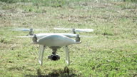 Super slow motion HD:camera drone Landing on the grass