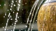 Super slow motion of fountain water splashing in the garden / Thailand