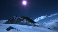 Super slow motion of skier jumping by night.