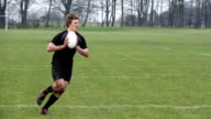 Super Slow Motion,  Rugby players passing the ball in Match