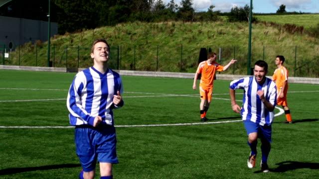 Super Slow Motion, Soccer / Football Players celebrate scoring goal