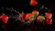 Super Slow Motion: Strawberries falling and splashing