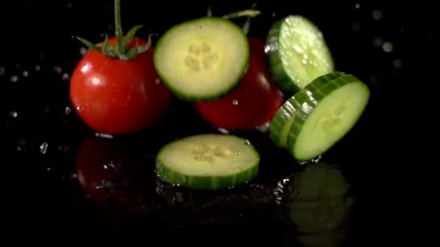 Super Slow Motion: Tomatoes & Cucumber splashing