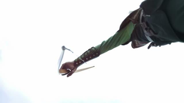 HD Super Slow-Mo: Archer Shooting An Arrow