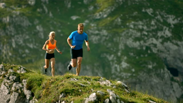 HD Super Slow-Mo: Athletes Running On A Mountain Trail