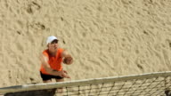 HD Super Slow-Mo: Beach Volleyball Player In Serving Action