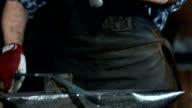 HD Super Slow-Mo: Blacksmith Cutting Steel