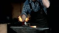 HD Super Slow-Mo: Blacksmith Hammering A Hot Metal