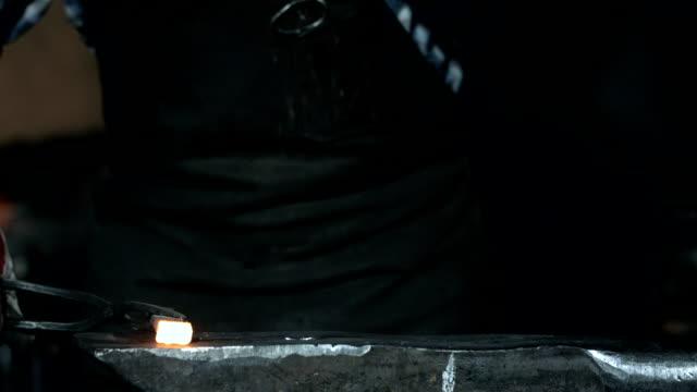 HD Super Slow-Mo: Blacksmith Hammering A Steel