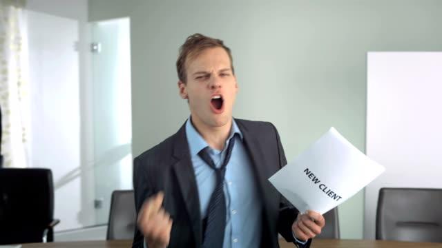 HD Super Slow-Mo: Businessman Cheering Acquiring A New Client