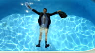 HD Super Slow-Mo: Businessman Falling Into Swimming Pool