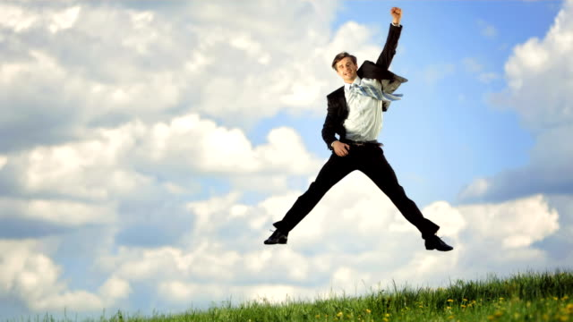 HD Super Slow-Mo: Businessman Jumping With Fist Raised