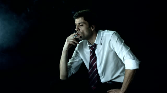 HD Super Slow-Mo: Businessman Smoking A Cigarette