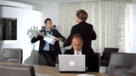 HD Super Slow-Mo: Businessmen Jostling In The Office