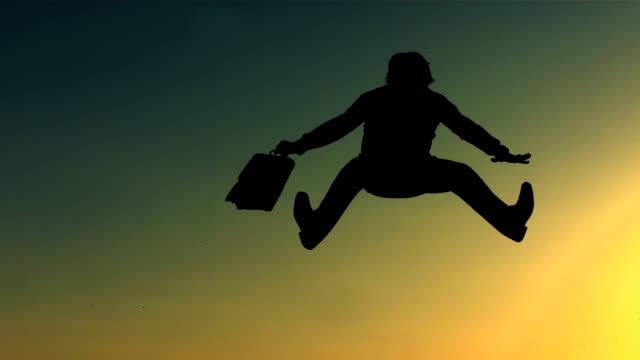 HD Super Slow-Mo: Cheerful Man Jumping At Sunstet