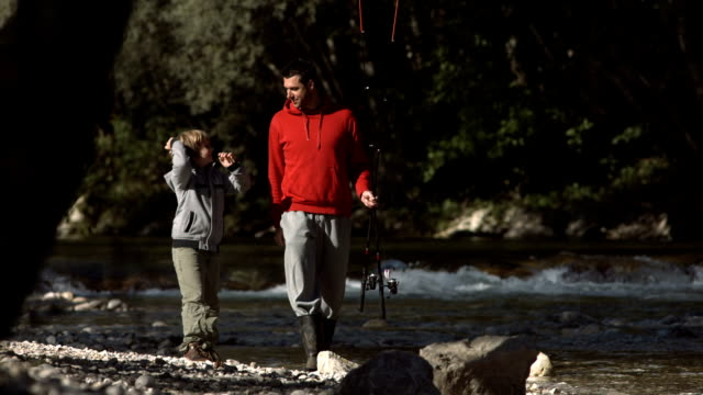 HD Super Slow-Mo: Cheerful Son Fishing With Father