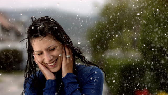 HD Super Slow-Mo: Cheerful Woman Dancing In The Rain