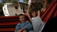 HD Super Slow-Mo: Children Having Fun In Hammock