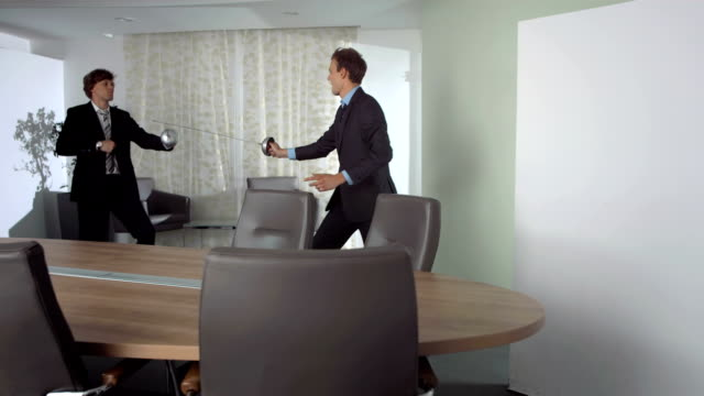 HD Super Slow-Mo: Competitive Businessmen Fencing