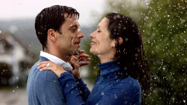 HD Super Slow-Mo: Couple Dancing In The Rain