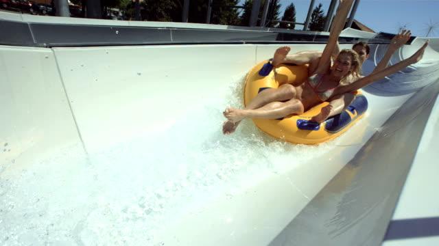 HD Super Slow-Mo: Couple Enjoying Raft Water Slide