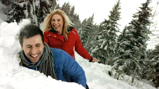 HD Super Slow-Mo: Couple Having Fun In The Snow