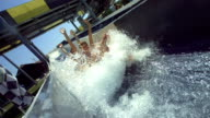 HD Super Slow-Mo: Couple Having Fun On Raft Water Slide