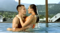 HD Super Slow-Mo: Couple Making Love In The Pool